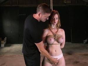 Busty redhead slave gets tits tied up and ass spanked