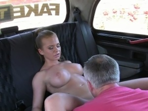Busty blonde sucks huge dick in fake taxi