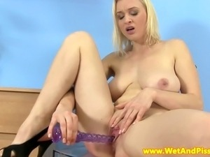 Pissing fetish busty blonde babe playing with pee and her toy