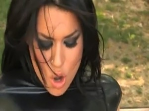Two girls in latex fuck with strapon