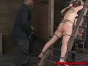 Redhead sub with pussy clamps being roughly punished