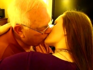 young girl controls old man