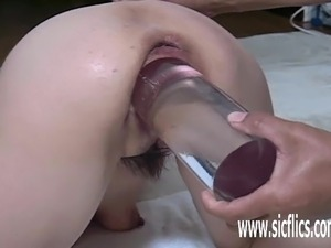 Asian wife fucked with a gigantic solid glass dildo