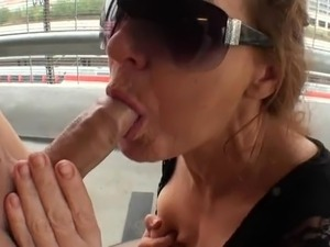 mature wife sucking cock in a parking-lot