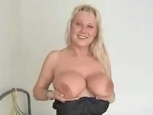 Busty blonde milf playing with her huge tits