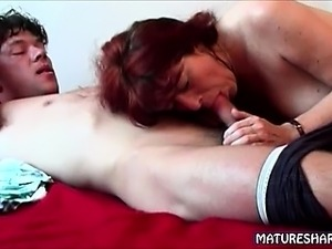 Mature Redhead Unleashes Young Cock