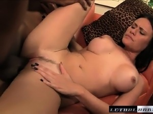 Cute brunette with big breasts Ashli Ames struggles with a black pole