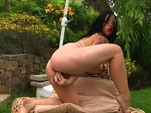 Stripping and masturbating her wet pussy