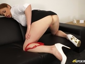 Adorable white redhead chick flashes her shaved pussy on the couch