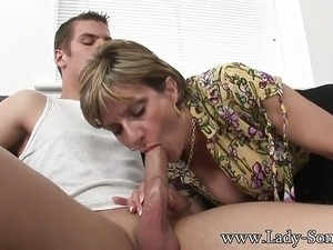 girl kneeling down to suck cock