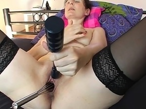 mature woman removing younger womans bra