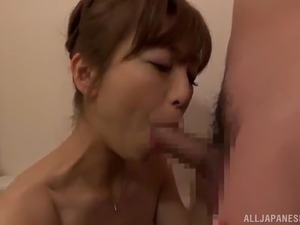 asian babe sucks on a guy's cock