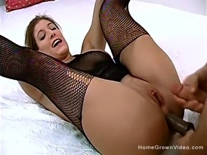 Sexy brunette in black fishnet stockings is as greedy as she is horny.