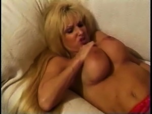 Blonde milf with big boobs get a dick on a table