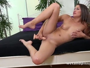 Horny chick Yenna is ready to have fun with her toy after a hot peeing session