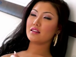 Really beautiful Asian babe Jade Luv is so into giving a stout blowjob