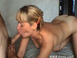 Stunning blond milf taking her husbands penis in her mouth